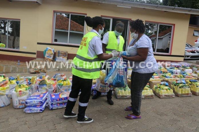 sonko rescue team giving food