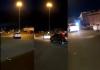 man seen dangling on a speeding car